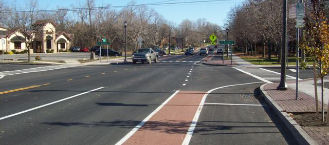 Photo of a bike lane and crosswalk at an intersection